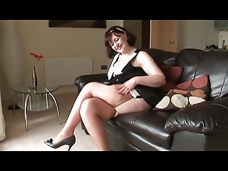 Busty mature tanya showing off shaved pussy mound