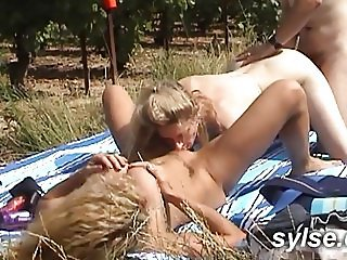 2 MILFs and young boy in vineyard with strapon