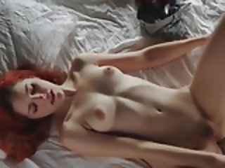 Beautiful redhead masturbates and orgasms for you