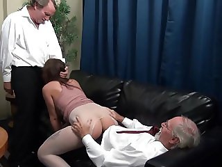 The dominant, older bosses coddles a young intern ...