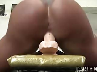 Nude Female Bodybuilder Fucks a Huge Dildo in the Gym