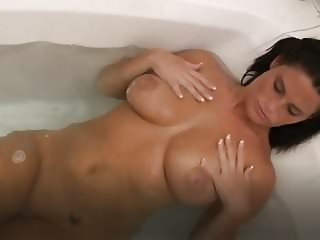 Beautiful Busty Babe in the bathtub