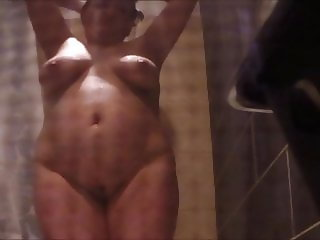 Unaware Fat Sister in Law in shower with saggy tits
