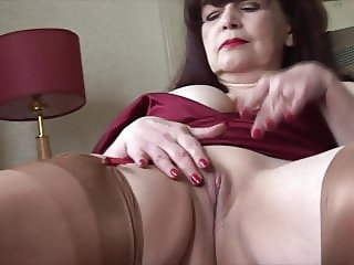 Horny mature babe with big tits stripping and spreading