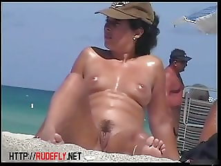 Beach girl nudist spreading her legs