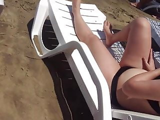 Sexy girl with bikini undressing at beach