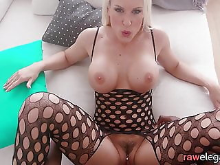 Bigtitted MILF riding black cock in closeup