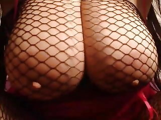 Arab girl in fishnet shakes her big tits and ass