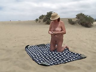 Mature shows herself on the beach