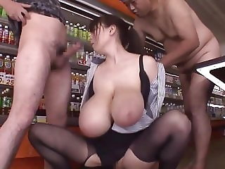 Massive boobed Japanese MILF banged by two studs...