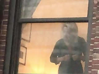NYC hotel window voyeur mature blonde dressing