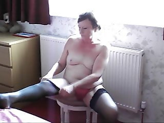Tiny Titted Milf getting dressed in front of the bedroom