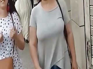 Arabic girl with big tits, spied in street with his girlfrie