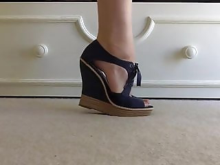 Zooming on beautiful feet in beautiful wedges - 2 pairs -.