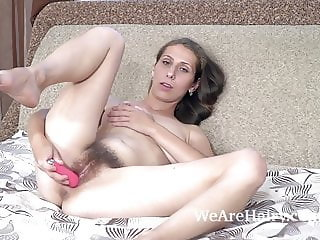 Baby Boom masturbates in bed with a pink toy
