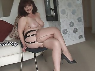 Big tits mature babe in stockings and mini skirt stripping