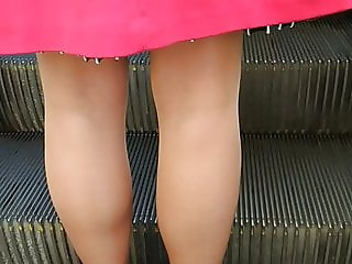 Pantyhose and heels on the escalator