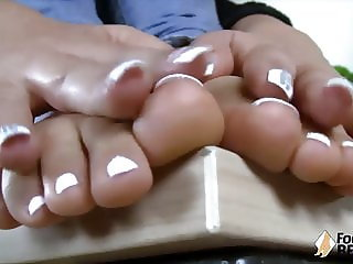 Teen takes off socks and shows her feet