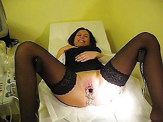 Medical gyno exam of shaved milf with tight vagina