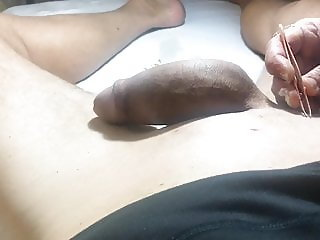 Brazilian Waxing of a Big Cock Part 4  She uses the Tweezers