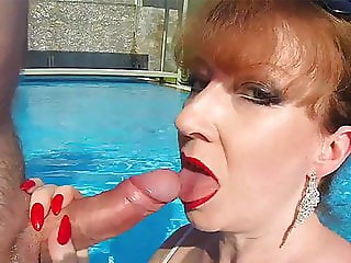British Mature Red XXX sucking cock in a pool