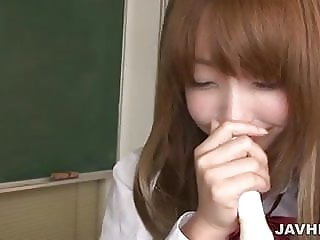 Schoolgirl Sana Anju uses a flute to titty fuck her tits and