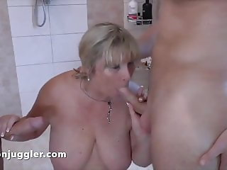 An older woman using two well hung studs