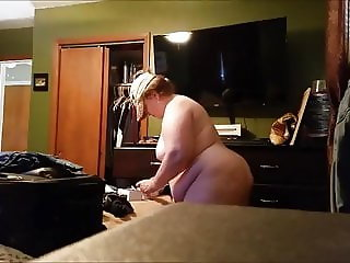 Chrissy Nienhardt nude with hat on cleaning dresser