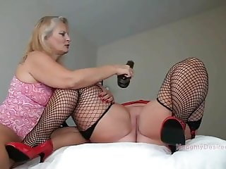 Aunty Alex uses her magic wand in Desiree's pussy