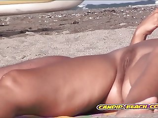 Spread legs big pussy hot naked nudist milf spied at beach