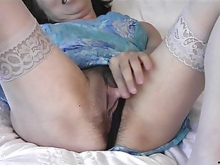 nicely caresing her clit