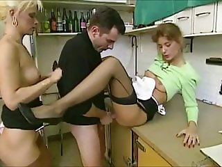 Nice women in stockings get seduced in kitchen of bakery