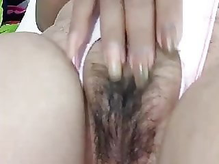 Thai Grandma masturbate her wet and hairy pussy 2