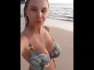 Busty Nastya. Walking bouncing tits on the beach.