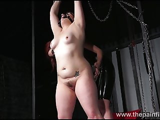 Lesbian whipping of slave Isabel Dean in painful femdom bdsm