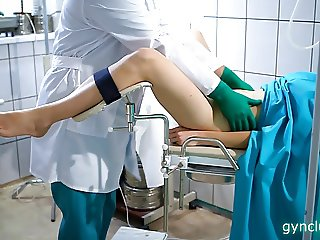 the girl is examined by a gynecologist