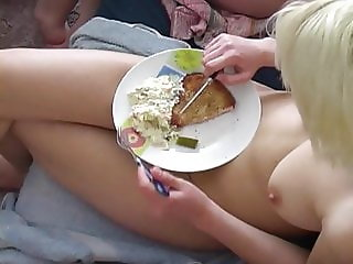 Nudist women cooking and eating
