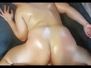 Thick brunette oiled up teasing and doggy style