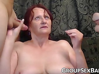 Redhead mature slut pounded at gangbang party