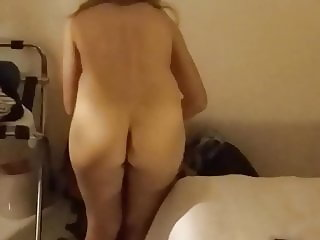 Window peeping - Cute blonde student naked in her room