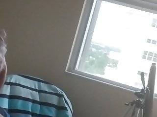 wife changing in front of window