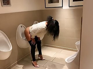 London girl uses urinal in mens toilet