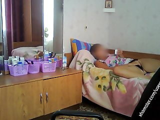 Student resting on the bed in black panties. Hacked laptop c