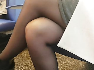Young student wearing pantyhose in train