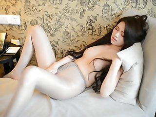 Chinese Girl in Hotel Room Making Mess