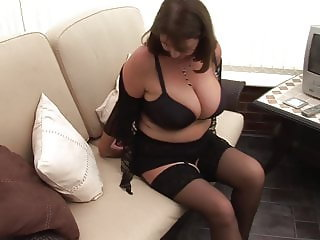 Mature brunette with huge tits teasing in mini skirt