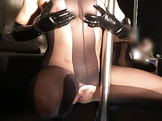 Masked MILF with big boobs poledancing in a webcam show