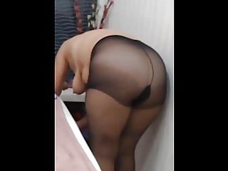 Showing me some clothes. Hidden cam