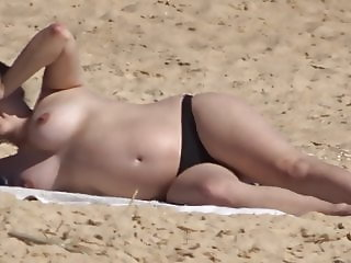 Gorgeous pregnant woman at the beach