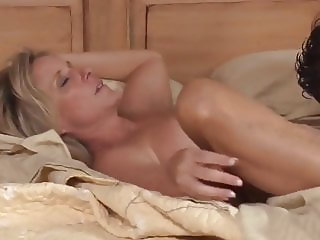 busty sexy milf shares the bed with her young roommate boy